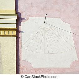 Sundial clock on the wall