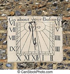 Sundial on the church wall in Clare, Suffolk