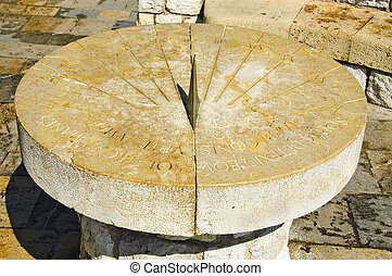 sundial - closeup to an old stone sundial