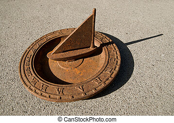 Sundial sailboat - An old steel nautical sundial in the...