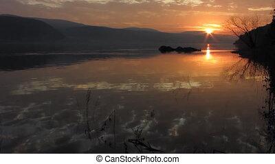 Sundown 3 - The Sundown sun on river.