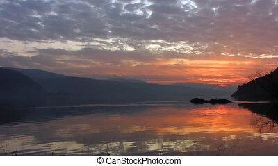 Sundown 9 - The Sundown sun on river.