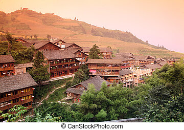 Sundown at wooden tradition Miao type Longji mt house at...