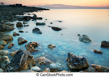 Sundown - Beautiful sundown composition. Sea and rocks ad...