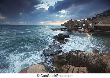 Sundown in the mediterranean at city of Acre in Western...