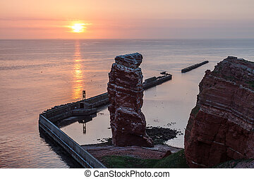 Sundown on Helgoland with Lange Anna and calm sea