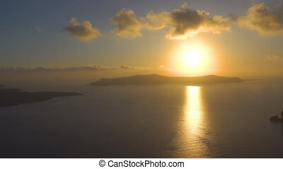 Sundown over sea in Santorini, - Scenic sundown over sea in...