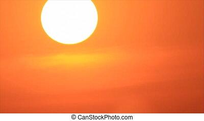 Sundown through light veil clouds