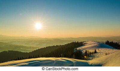 Sundown time lapse in winter mountain