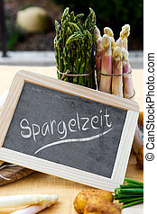 Asparagus with blackboard and german word