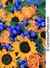 Sunflower arrangement in blue and yellow