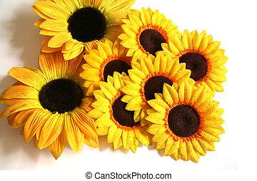 An arrangement of artificial sunflowers