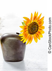 Sunflower in a vase on white table
