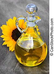 Sunflower oil bottle with stopper and flower