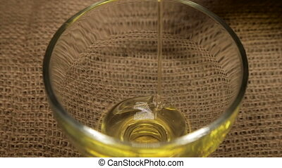Sunflower seed oil in a glass bowl close-up.