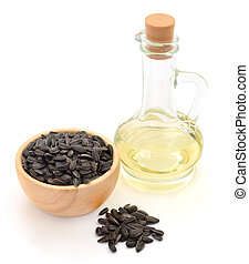 Sunflower seeds and oil. Isolated on white.