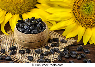 Sunflower seeds on the wooden table