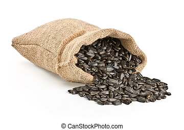Sunflower seeds, poured out of a bag, isolated on white ...