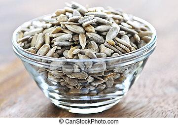 Sunflower seeds - Shelled sunflower seeds close up in glass ...