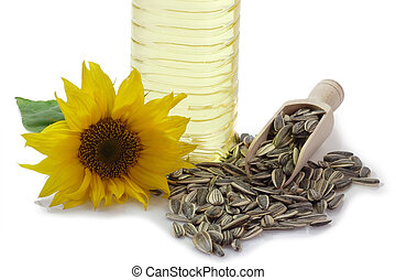 Sunflower Seeds with Blossom and Oil - Sunflower seeds on a...
