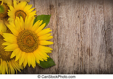 sunflowers are on the wooden