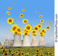 Sunflowers come out from chimneys of a power plant