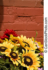Sunflowers in Front of Red Brick