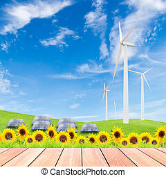 sunflowers with wind turbine and solar panels on green grass fie