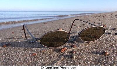 sunglass on summer sea beach
