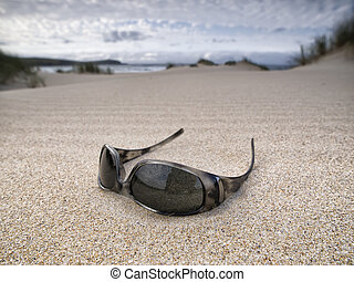 Sunglasses abandoned on the beach