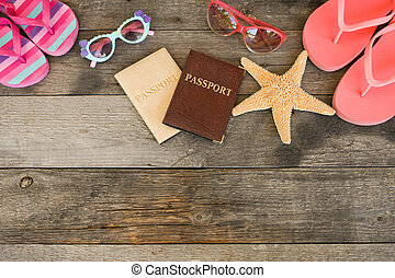 Sunglasses and beach slippers and passport on wood a background