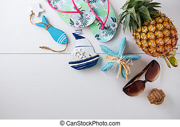 Sunglasses and summer accessories on white background