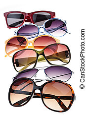 Sunglasses - Assorted styles of tinted sunglasses isolated...