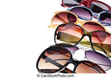 Assorted styles of tinted sunglasses on white background close up