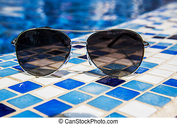 Sunglasses at the pool