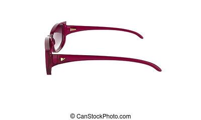 Sunglasses rotates on white background