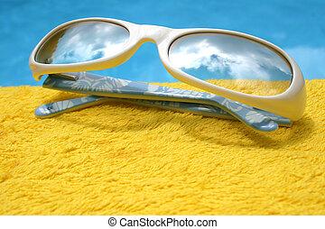 Sunglasses - Futuristic sunglasses on yellow towel by pool