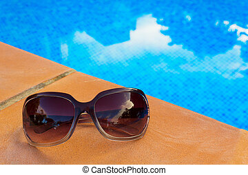 Sunglasses near pool
