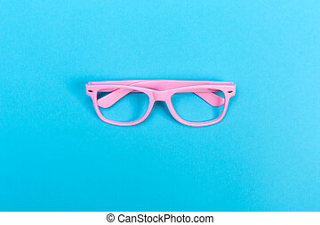 Sunglasses on a bright blue background