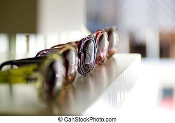 sunglasses on a shelf