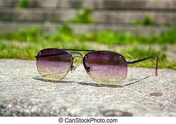 Sunglasses on a stone