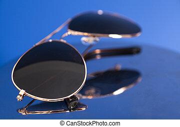 Sunglasses On Blue Background