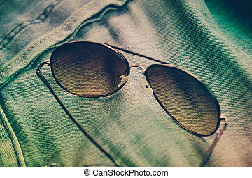 sunglasses on jean with filter effect retro vintage style