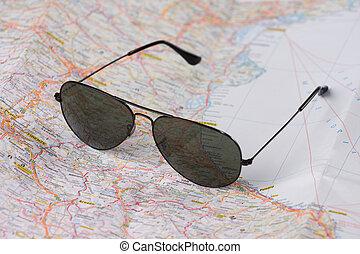 sunglasses on map