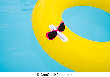 Sunglasses On Ring In Swimming Pool