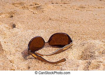 Sunglasses on the beach near the sea