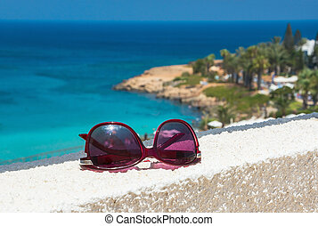 Sunglasses on the sea background