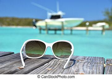 Sunglasses on the wooden jetty. Exuma, Bahamas