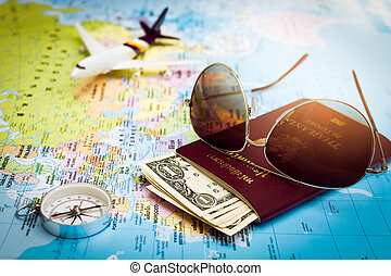 Sunglasses, Passport, Money, Compass and aircraft on the world map