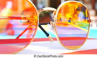 Sunglasses. Pool reflection. Concept of holiday at sea. Observations children, play. TimeLapse.
